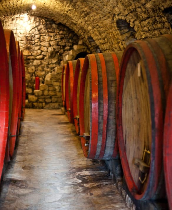 Oak wine barrels stored in the 15th century stone cellar at Tvrdos Monastery, Trebinje.