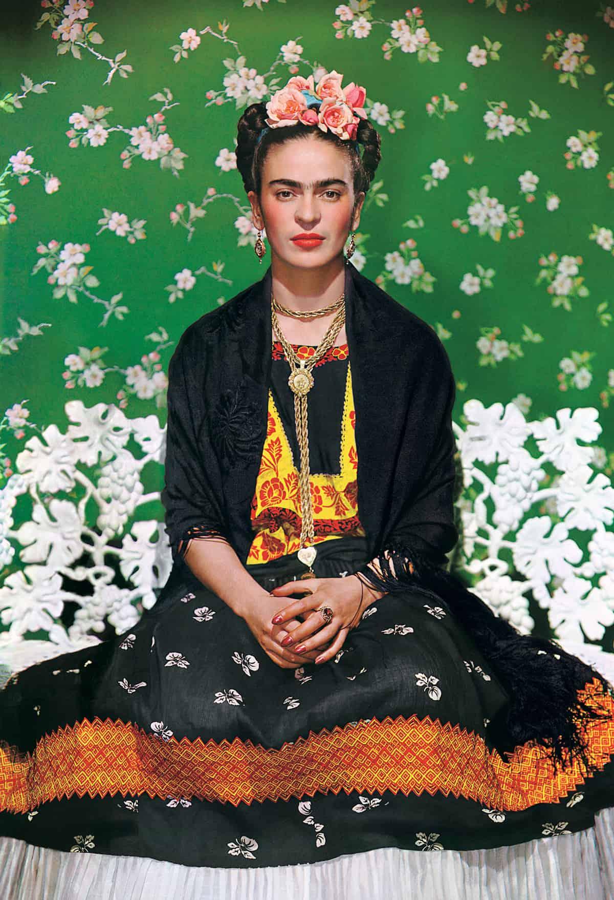 Nickolas Muray Frida Kahlo on white bench 1938 The Jacques and Natasha Gelman Collection of Mexican Art © Nickolas Muray Photo Archives